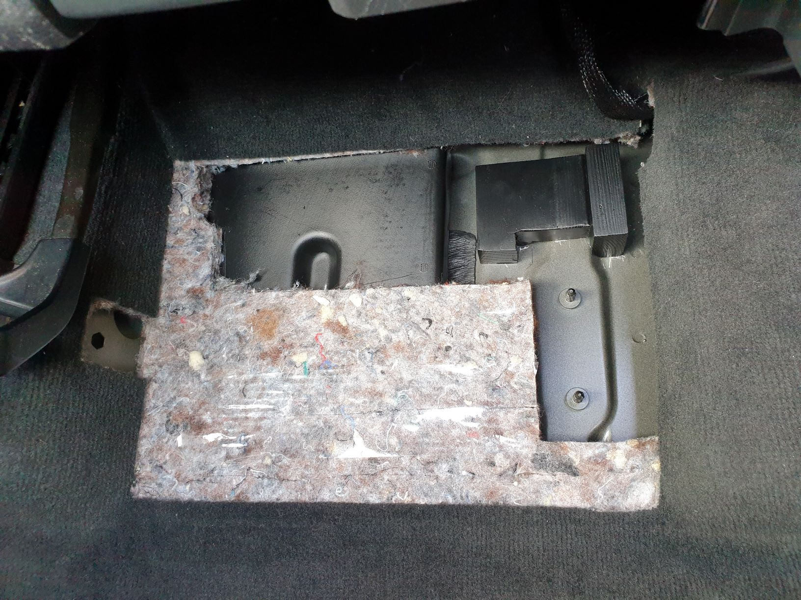 carpet removal under passenger seat.jpg