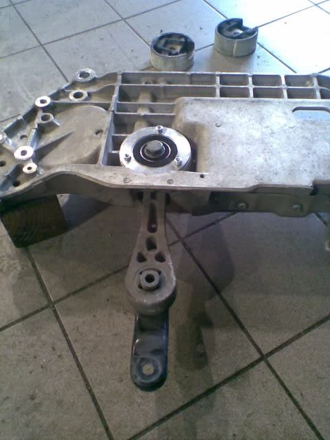 two round mounts go into subframe before dogbone slides in.jpg