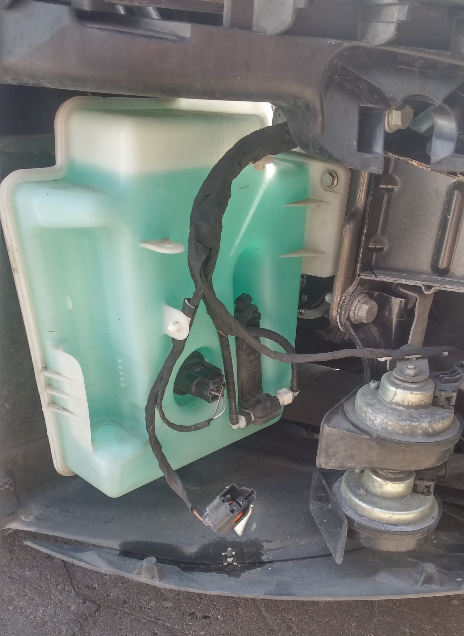 Washer tank without headlight washer pump.jpg